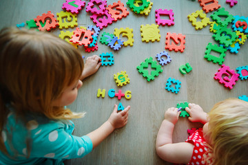 kids playing with puzzle, learning numbers