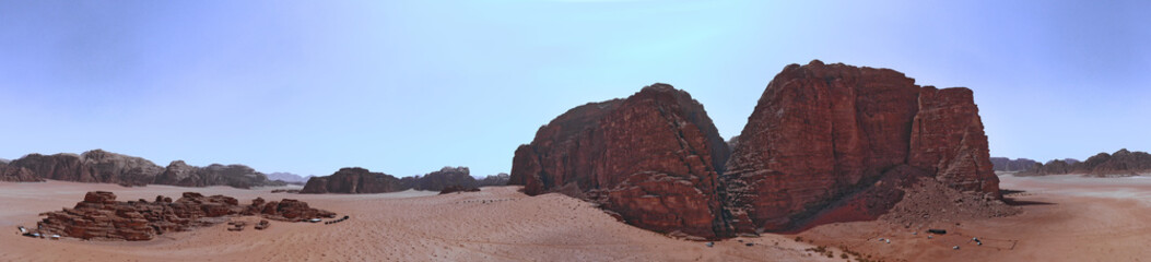 Composite panorama of high resolution aerial photos of a monolithic mountain in the central area of the desert reserve of Wadi Rum, Jordan