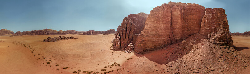 Aerial view of the gigantic rocks and mountains in the nature reserve of Wadi Rum, high resolution panorama, composed of single pictures
