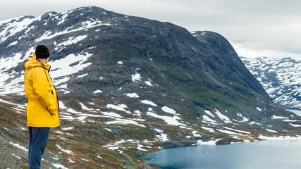 Tourist man standing by Djupvatnet lake, Norway