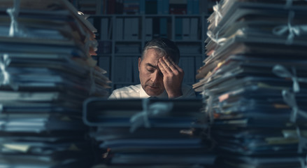 Business executive overloaded with work