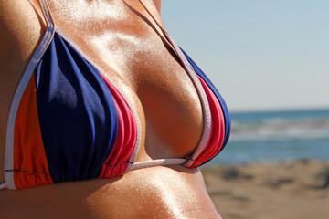 Girl with a beautiful body in colorful bikini