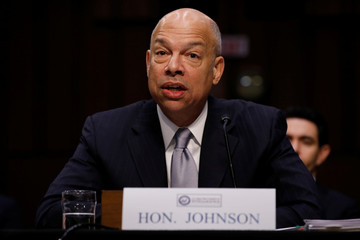 Former Homeland Security Secretary Jeh Johnson testifies before the Senate Intelligence Committee about election security on Capitol Hill in Washington