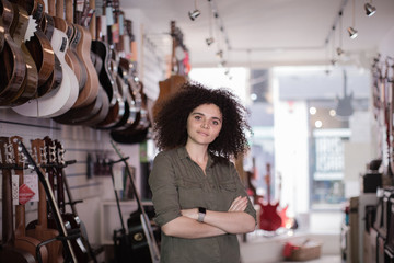 Portrait of a small business owner in a guitar store