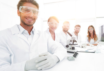 Male scientist and the team in the lab.