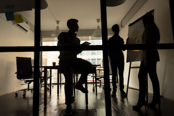Silhouette of Business people discussing about their business plan