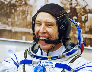 The International Space Station (ISS) crew member astronaut Drew Feustel of the U.S smiles after donning space suits shortly before the launch at the Baikonur Cosmodrome