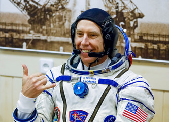 The International Space Station (ISS) crew member astronaut Drew Feustel of the U.S. smiles after donning space suits shortly before the launch at the Baikonur Cosmodrome