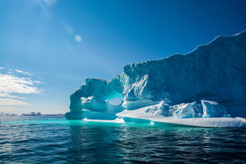 Amazing shine of iceberg. Iceberg in Greenland Wall mural