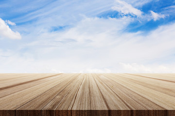 wooden plank table top with beautiful skies background