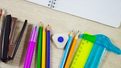 A variety of stationery on the table.