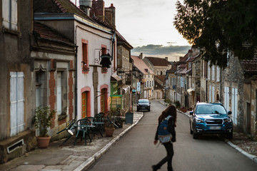 Narrow street in old french city Vezelay, evening time