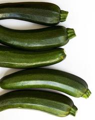 Zucchini (zucchetti, courgettes) on a white background