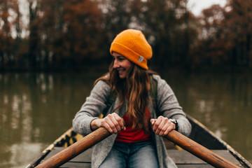 Woman sailing on small boat