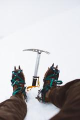 Legs of climber on snowy hill