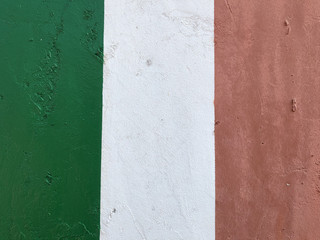 Italian flag, green red white, painted with paint on a concrete wall, emblem of the Italian state, symbol of patriotism and belonging to the republic, texture, background, travel, sport, Milan, Italy