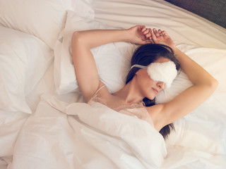 Pretty woman with furry sleeping mask