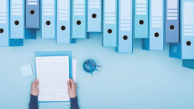 Office worker and archive binders