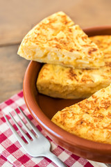 Traditional spanish omelette close up,  view from above. Spanish tortilla