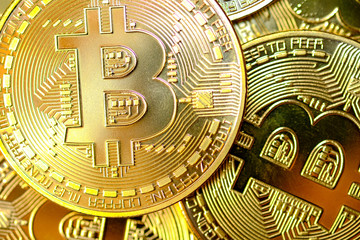 Close-up and selective focus a group of Golden Bitcoin, a virtual money of digital currency in the digital world (Internet and Online) is becoming popular. And can replace the real currency.