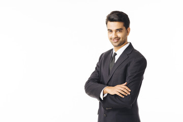 Portrait of a confident young man in business suit, isolated on white background