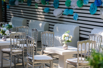 Vintage metallic silver style chairs and table with flowers
