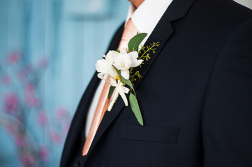 Colorful wedding boutonniere on suit