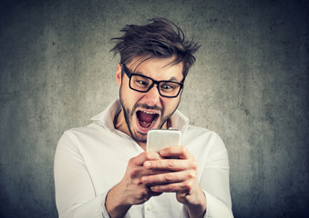 Super excited man watching smartphone