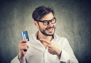 Excited man with credit card enjoying bank borrow