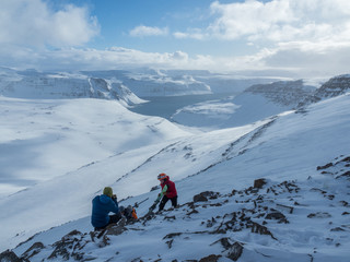 skiers on top of a mountain