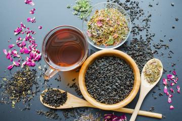 variety of black and herbal dry tea leaves, top view