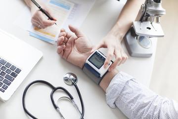 SEnior patient examining his blood pressure. Hypotension.