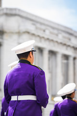 Soldier in formation outside pillar building
