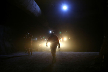 A miner walks inside 'El Teniente' copper mine of Chile's state copper giant Codelco in Rancagua