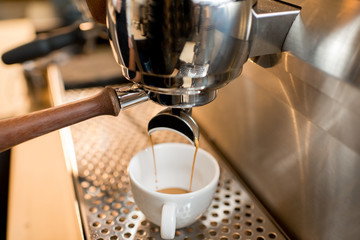 Close-up view on the professional coffee machine making espresso