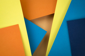 abstract composition of blue and orange papers
