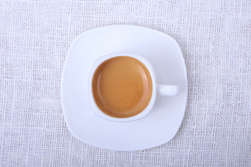 Classic espresso in white cup on white background. Top view.