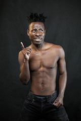 emotions black young man on a black background