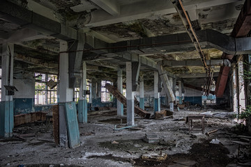 Abandoned rotten and overgrown industrial building in Sukhum, Abkhazia. Consequences of war