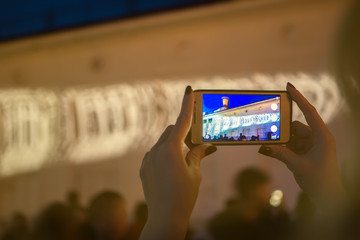 people take picture of night light show