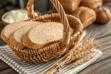 Basket with cut bread on table