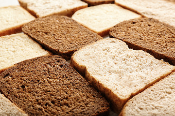 Slices of wheat and rye bread, closeup