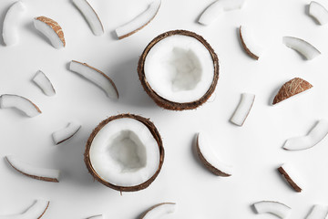Ripe coconuts on white background, top view