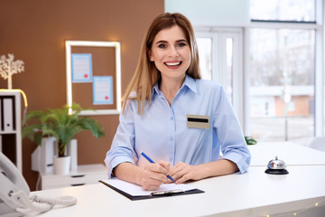 Female receptionist at hotel check-in counter