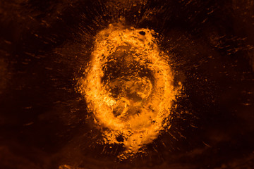 Upper view photo of a sparckle fire effect on ice texture background.
