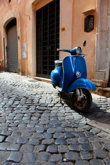 Fotorolgordijn Scooter Vintage blue motor scooter on Roman cobblestone street