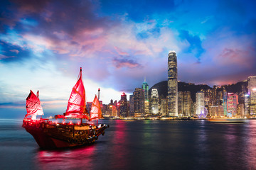 Victoria Harbour Hong Kong night view with junk ship on foreground Fotomurales