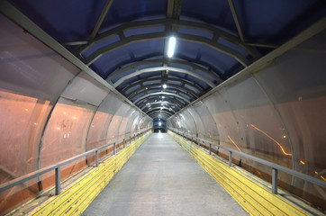 Papiers peints Tunnel dirty, unkempt pedestrian transition over the highway. night. Russia.