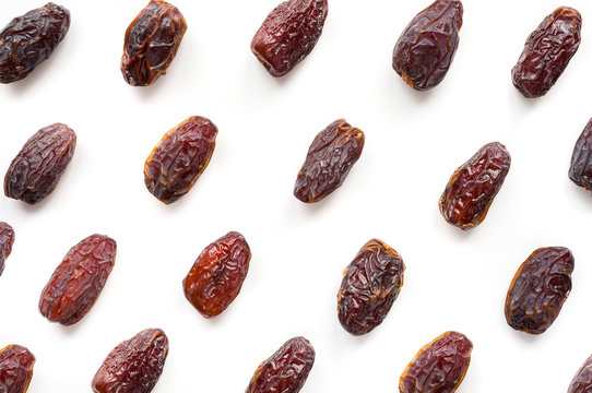 Isolated Medjool Dates. Top view. Fruit pattern.