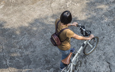 Asian woman with folding bicycle